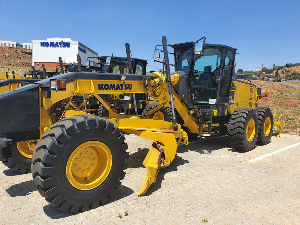 Komatsu's GD675 mining grader used to clear and maintain loading, dumping and haul surfaces