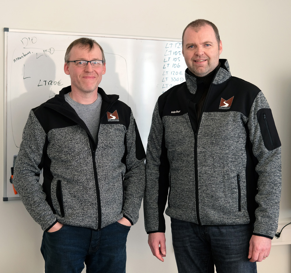 Hörður Pétursson, the managing director of the operation of Steypustöðin (right), and Sigurdur Sigursson, servicing manager, with a list of their twenty Metso Outotec products behind them