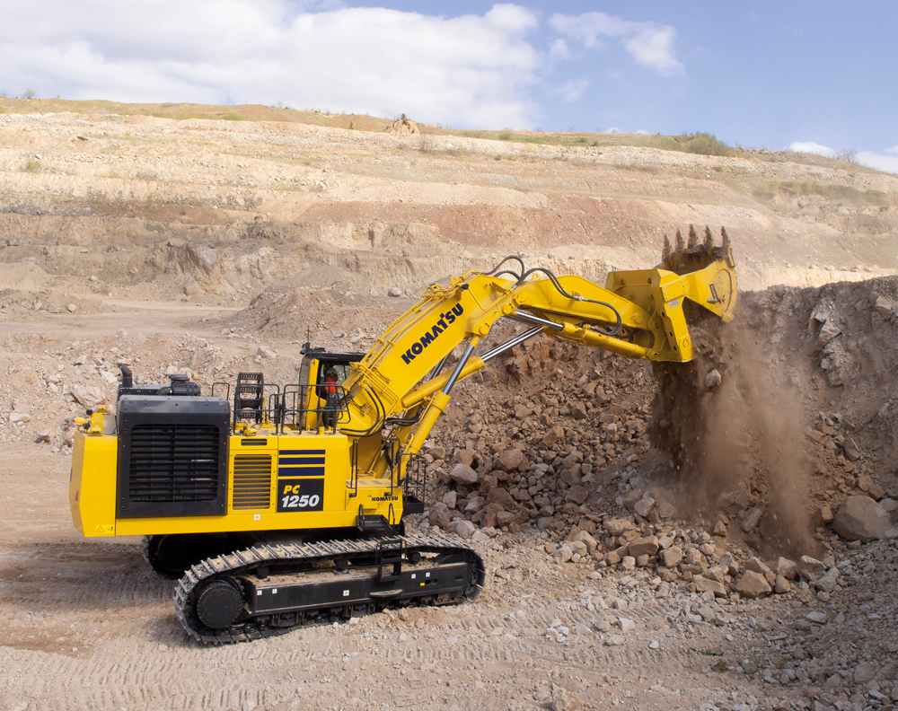 To extract dolomite, the Komatsu PC1250-11 directly rips at the face with its front shovel