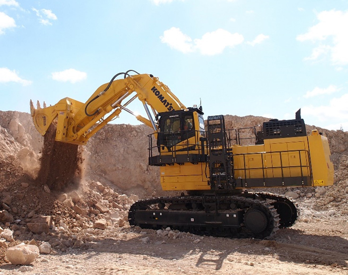 The cab elevation helps the operator see where the material is loaded in the truck's body.