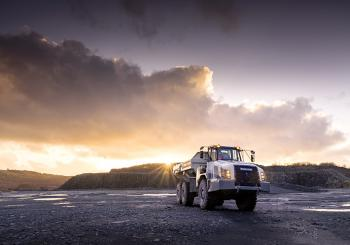 A Terex Trucks TA300 articulated hauler pictured at a Scottish quarry site at sunset