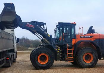 The Mick George Group has received Britain's first new Doosan DL-7 wheeled loaders. Pictured is one of the company's DL420-7 models