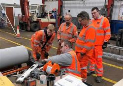 Martin Engineering's Mr Blade service engineer Richard Green trains a team from Response on the fitting and servicing of Martin products