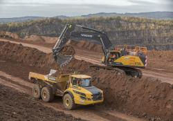 A Chepstow Plant International Volvo EC750E excavator and Volvo A40G articulated haul truck carrying out quarrying work