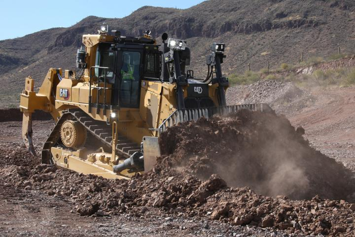 The new Cat D9 dozer pushing dirt
