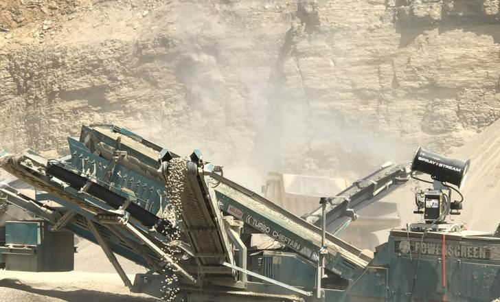 A Spraystream system fitted to a three-way split screener in operation at a quarry in Germany